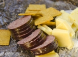 Wheat thins, beef summer sausage, and English cheddar