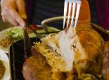 Ariana carving the turkey