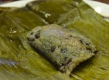 Sticky rice and black beans in banana leaves