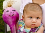 Giant onion with Baby Hannah