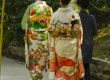 Japanese ladies walking down the camelia pathway
