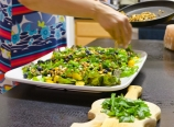 Kandus making salad