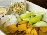 Hummus, brie, walnuts, pear, and crackers