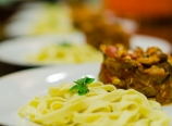 Pasta with stacked puttanesca topping