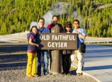 Family at Old Faithful Geyser