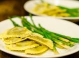 Wild mushroom ravioli with asparagus