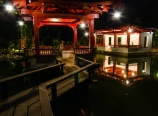 Gazebo seats and pond at night