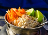 Pad Thai with lime, carrots, and peanuts