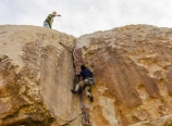 Heading up the overhanging crack