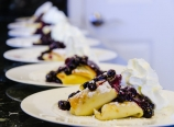Blintzes with blueberry sauce