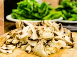 Sliced mushrooms and spinach leaves
