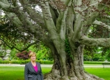 Ann Van Heest by the purple tree